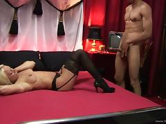 Horny blond milf, wearing stockings, enjoys jumping on a cock tube porn video