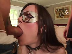 Masked brunette Sasha Grey works on two boners and enjoys a DP tube porn video