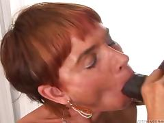 A mature white woman gets fucked and filled with cum by a black guy tube porn video