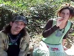 An amateur hippie couple gets naked and fucks out in the forest tube porn video