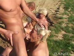 Granny sluts in the mud sucking cock and getting fucked in group sex tube porn video