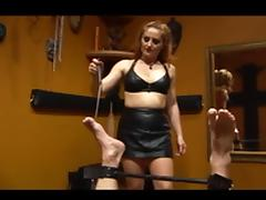 Mistress in leathers & nylons playing with her bound slave tube porn video