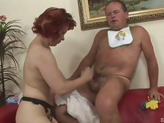 She dresses him in a diaper then pegs him in the ass tube porn video