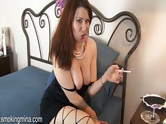 Smoking brunette model fingering her pussy in high heels tube porn video