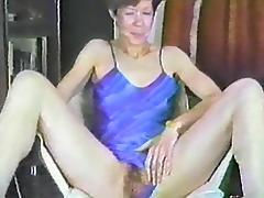 A hairy girl spreads her legs and fingers her big bush tube porn video