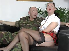 Military man puts a milf in a gag and cuffs and bangs her tube porn video