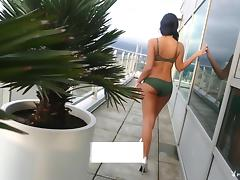 Icy hot brunette bares it all for a spicy shoot on the balcony tube porn video