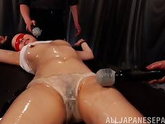 Tied down and blindfolded Japanese slut oiled up and played with tube porn video