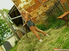 Cute farm girl takes a break to masturbate in a pile of hay tube porn video