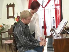 Older redhead piano teacher gives free lessons to her sexy student tube porn video