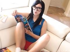 Nerdy, cute teen reads a comic book while massaging her clit tube porn video