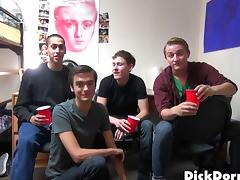 Skinny gay guy with glasses enjoying a hardcore gangbang tube porn video