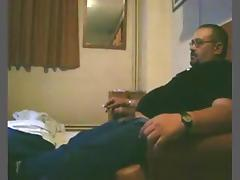 Dude smokes a cig, while his bbw wife sucks and rides him on the sofa. tube porn video