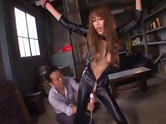Kinky Asian in a leather catsuit sucks dick erotically tube porn video