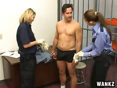 Horny and steamy guards give a prisoner a superb jerk off in the cell tube porn video