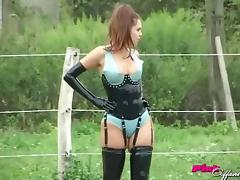 Latex fetish babes play in the dirt and grass on the farm tube porn video
