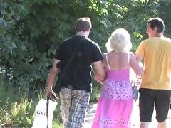 Granny and a couple of college guys have a threesome in the woods tube porn video