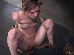 Crazy bondage and caning for this pretty girl in his dungeon tube porn video