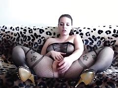 Hot woman wearing a black bodystocking plays tube porn video
