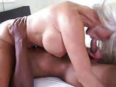 Busty granny enjoys riding hard on a massive black shaft tube porn video