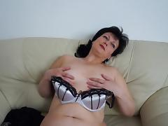 Chubby mature hussy Julie enjoys masturbating on a couch tube porn video