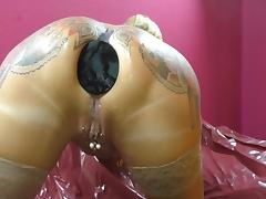 Tattooed Woman Spitting Butt plugs Out Of Her Arsehole. tube porn video