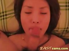 Pretty korean girl is filmed sucking a small cock and taking its cum all over her face. tube porn video