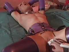 Hot lesbians have fun with latex tube porn video
