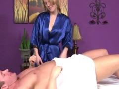 Brunette masseuse rubs customers cock tube porn video
