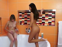 Angel Piaf and Iwia fist each other's pussies in the bathroom tube porn video