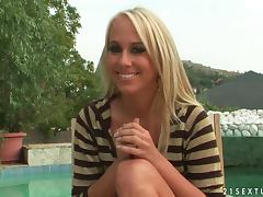 Blonde hottie Carla Cox gives an interview on the poolside tube porn video