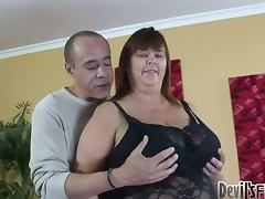 This fat babe in black corset enjoys this dudes huge cock tube porn video