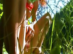 Petite french chick peeing in a forest tube porn video
