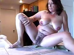 Chubby mature whore plays with her hairy cunt in front of a webcam tube porn video