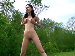 Sporty babe Yulia is getting naked in the forest tube porn video