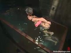 Slim blonde girl gets her pussy toyed under water jet tube porn video