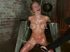 Nipple pumping in an oiled up bondage for Isis tube porn video