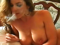 Slender lady in nylons is smoking a cigarette tube porn video