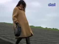 Hot Jap slut releases a golden shower in the open air tube porn video