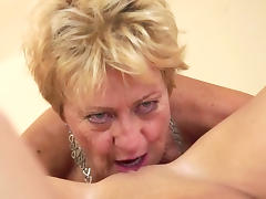 Mature blonde eats alluring brunette's pussy tube porn video