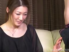 Japanese milf gives an awkward blowjob to some guy tube porn video