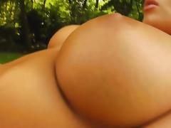 Busty slut rubs her pussy in the outdoors tube porn video