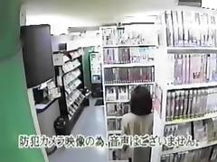 Asian woman watching porn and masturbating in video room tube porn video