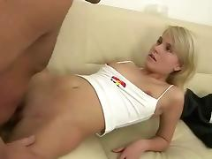 A young blonde girl and a guy are watching something on a laptop... tube porn video