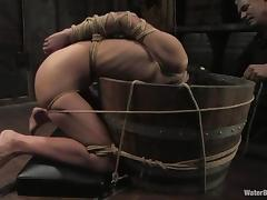 Skinny Amber Rayne gets tied up and drowned in water tube porn video
