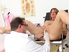 Grown-up is seated in the matter of iatrical easy chair almost spread fingertips tube porn video