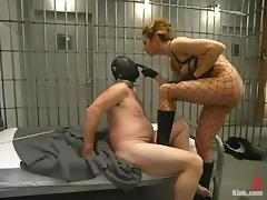 Hot mistress in police uniform dominates a guy in a prison tube porn video