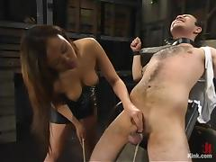Asian hussy Annie Cruz enjoys torturing Sir C in a basement tube porn video