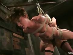 Harmony dominates and fucks slutty chick Sara Faye in a cellar tube porn video