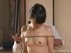 A slim Japanese girl gets tied up and fingered by older man tube porn video